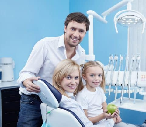 Happy family at the dentist