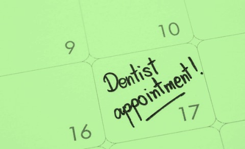 A calendar displaying a dentist's appointment reminder